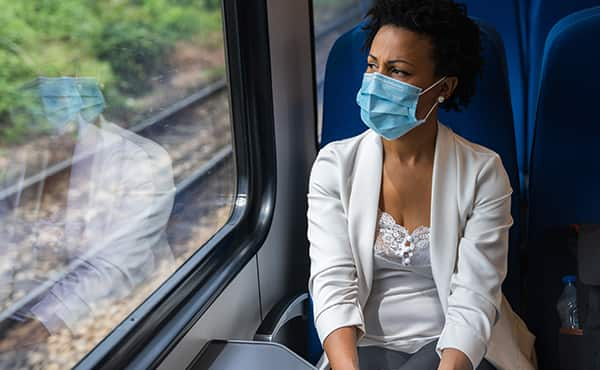 masked woman on train